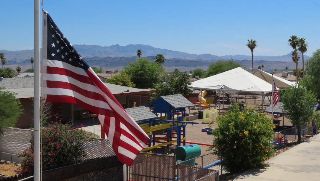 American flag flapping infront of the preschool
